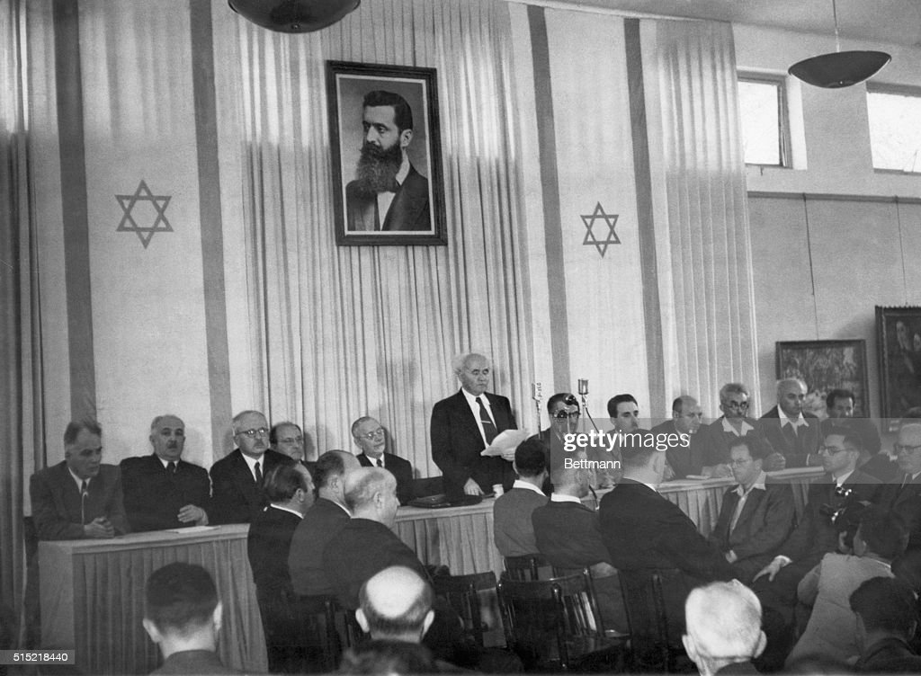Tel Aviv, Israel- Members of the newly created state of Israel gathered to hear Prime Minister <a gi-track='captionPersonalityLinkClicked' href=/galleries/search?phrase=David+Ben+Gurion&family=editorial&specificpeople=93274 ng-click='$event.stopPropagation()'>David Ben Gurion</a> read the Jewish 'Declaration of Independence.' Left to right: Baruch Schitrit, Minister of Arab Affairs and Police; David Remez, Minister of Communications; Felix Rosenblueht, Minister of Justice; Fritz Bernstein, Minister of Trade; Rabbi Juda Fishman of Jerusalem; <a gi-track='captionPersonalityLinkClicked' href=/galleries/search?phrase=David+Ben+Gurion&family=editorial&specificpeople=93274 ng-click='$event.stopPropagation()'>David Ben Gurion</a>, Prime Minister and Defense Minister; Moshe Shapiro, Minister of Immigration; Moshe Shertock, Minister of Foreign Affairs; Eliazar Kaplan, Minister of the Treasury; M. Ben Tov, Minister of Labor; and A. Zisling, Minister of Agriculture.
