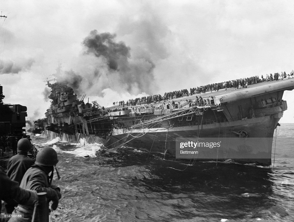 5/17/1945Listing badly the Franklin seems about to capsize as the cruiser Santa Fe which rushed to pour water on the flaming ship moves away Driven...