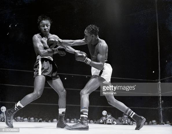 5/18/1951New York New York Kid Gavilan slams a hard right to Johnny Bratton's head closing his eyes and sending his hair flying during their 15round...