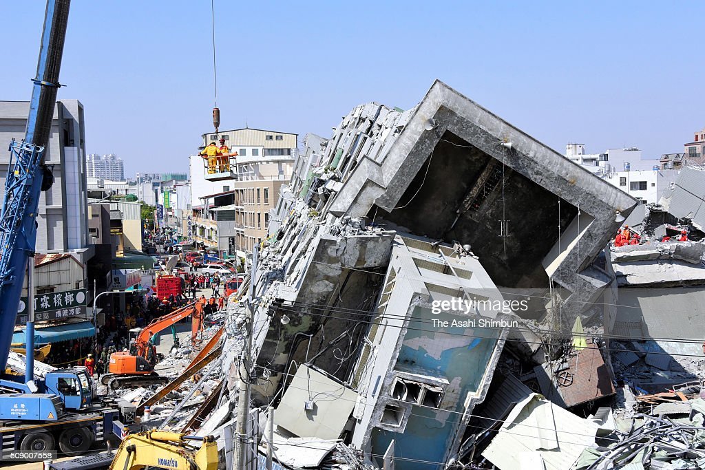 A 51-year-old man is rescued and carried by a crane from a collapsed building 56 hours after the magnitude 6.4 earthquake jolted on Saturday on February 8, 2016 in Tainan, Taiwan. The crucial 72-hour approaching, more than 100 people are believed to be trapped in the building.