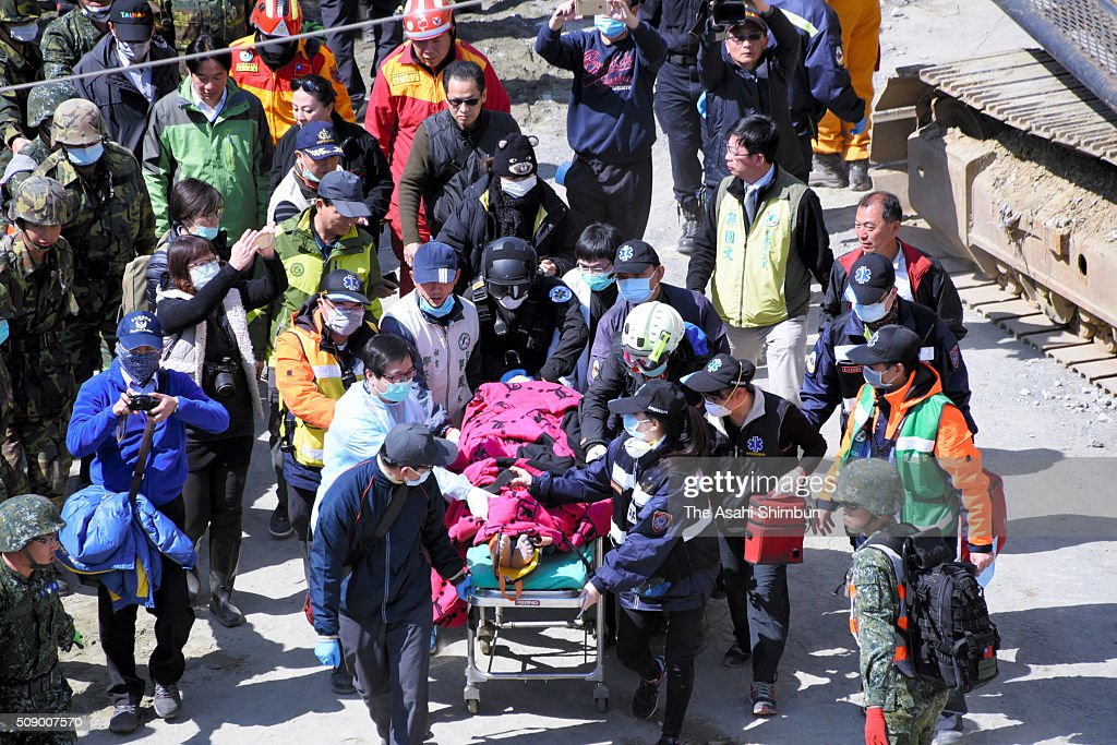A 51-year-old man is rescued and carried to a hospital from a collapsed building 56 hours after the magnitude 6.4 earthquake jolted on Saturday on February 8, 2016 in Tainan, Taiwan. The crucial 72-hour approaching, more than 100 people are believed to be trapped in the building.
