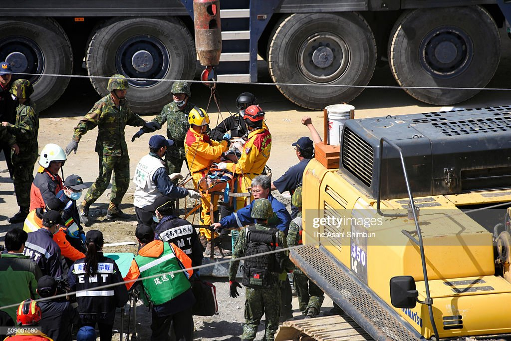 A 51-year-old man is rescued and unloaded from a crane from a collapsed building 56 hours after the magnitude 6.4 earthquake jolted on Saturday on February 8, 2016 in Tainan, Taiwan. The crucial 72-hour approaching, more than 100 people are believed to be trapped in the building.