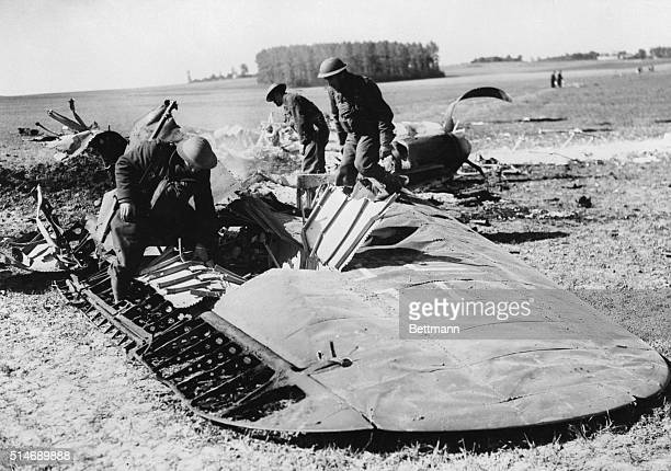 5/20/1940Somewhere in Belgium The wreckage of a German Heinkel bomber is searched by tommies after the plane was brought bown by a British...