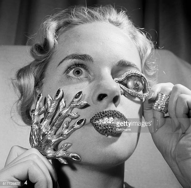 5/23/1959New York NY Looking like the backseat driver of a flying saucer Madelle Hegeler shows off weirdly striking jewelry by Salvadore Dali in New...