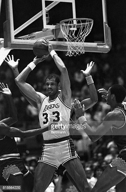 5/23/1984Inglewood CA Los Angeles Lakers center Kareem AbdulJabbar is surrounded by hands as he attempts a pass in the 1st period of the 5th game in...