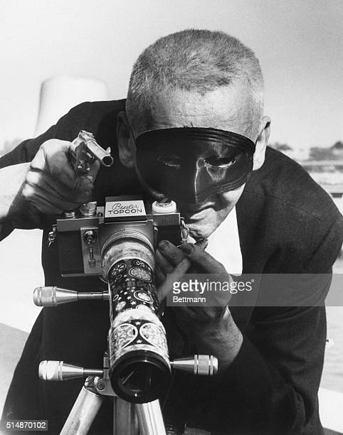 5/24/1965World's Fair NY This is Weegee himself almost Behind a black mask he borrowed from Zorro he brandishes a toy pistol and a big cigar ready to...
