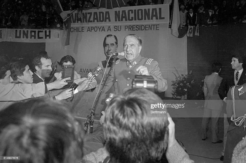 Santiago, Chile- Chilean President General <a gi-track='captionPersonalityLinkClicked' href=/galleries/search?phrase=Augusto+Pinochet&family=editorial&specificpeople=93107 ng-click='$event.stopPropagation()'>Augusto Pinochet</a> addresses supporters in a downtown Santiago theater. The rally, attended by some 5,000 people, was organized by a right-wing political group called 'Avanzada Nacional' to muster support for Pinochet in the face of opposition attacks on the President for alleged fraud in the purchase of a 35-acre mountain retreat.