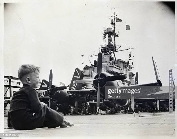 5/26/1948New York NY Thomas Heilienk sits on the flight deck of the Aircraft Carrier Valley Forge gazes at the war planes and exclaimes 'Gee it's a...