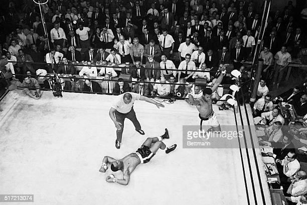 5/27/1965Lewiston ME A dramatic overheard photo reveals Sonny Liston spreadeagled on the canvas as heavyweight champion Cassius Clay raises his arms...