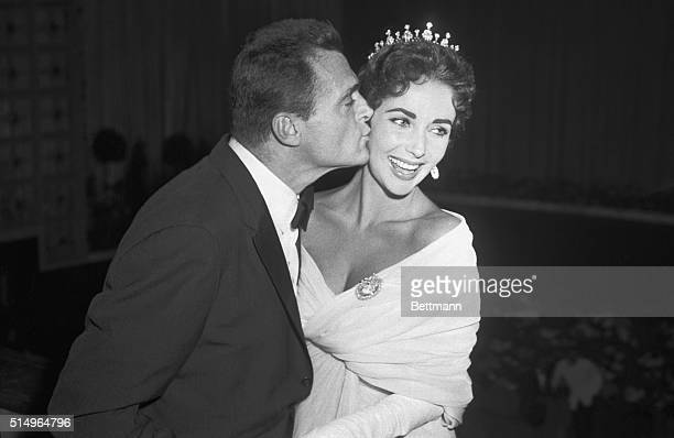 5/4/1957Cannes France Producer Mike Todd on top of the Cinema world kisses his wife actress Elizabeth Taylor at the International Film Festival in...