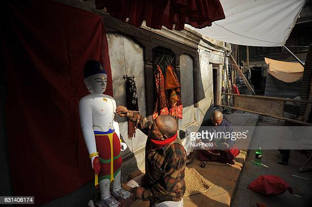 BAJRACHARYA 55yrs old and RAJU MUNI BAJRACHARYA 42yrs old priest decorates the idol Seto Machhendranath at Jan Bahal Kathmandu Nepal on Tuesday...