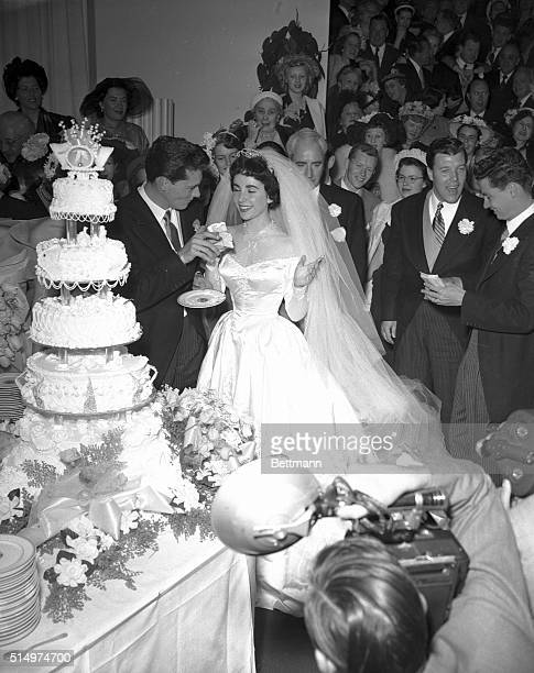 5/6/1950Hollywood CA Shown here are the newlywedded couple Conrad Nicholas Hilton Jr and his actress bride the former Elizabeth Taylor as he is about...