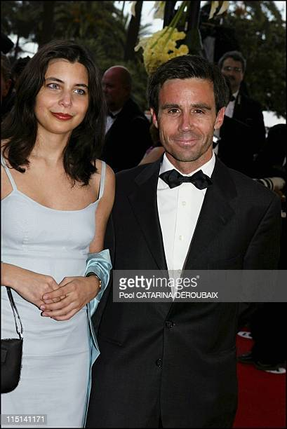 57th Cannes Film Festival Stairs of 'Zivot je cudo' in Cannes France on May 14 2004 David Pujadas and a friend