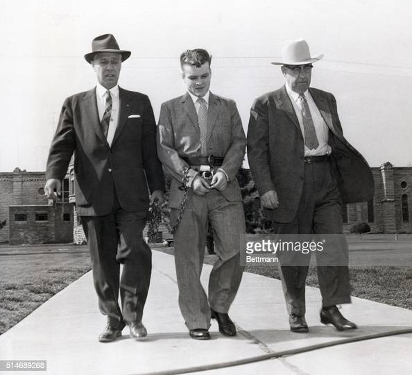 5/8/58Lincoln Nebraska Charles Starkweather admitted massslayer is flanked by sheriff Merle Karnopp and chief deputy Les Hasson as he is led from...