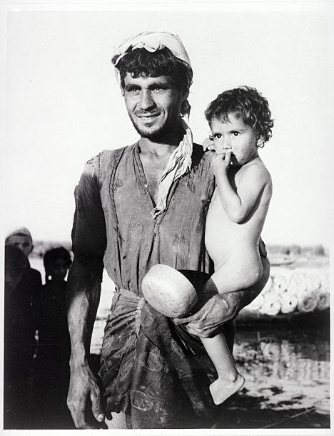 Iraqi father holding his young son pictures getty images iraqi father holding his young son publicscrutiny Gallery