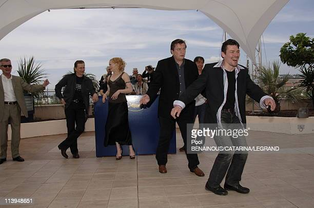 59th Cannes Film Festival Photo Call of Laitakaupungin Valot in Cannes France on May 22 2006Actor Ilkka Koivula actor Janne Hyytiainen director Aki...