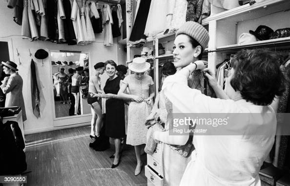 Ginette Spaniel directrice of Pierre Balmain's Paris fashion house coordinates the backstage goingson at a fashion show