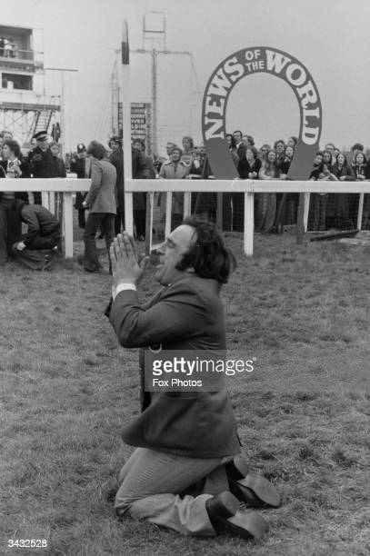 Barry Ellison the head stable lad for Red Rum praying during the 1975 Grand National