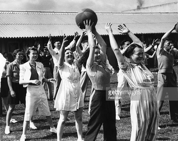Campers playing with a ball at Butlin's Holiday Camp Skegness Lincolnshire Original Publication Picture Post 193 Holiday Camp pub 1939