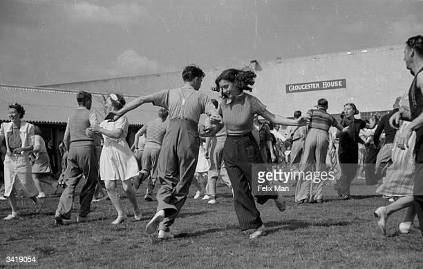 Holidaymakers country dancing at Butlin's Holiday Camp Skegness Lincolnshire Original Publication Picture Post 193 Holiday Camp pub 1939