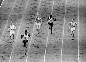Arthur Wint of Jamaica wins the semifinal of the 400 metres event at the 1948 London Olympics with Morris Curotta of Australia in second and Mal...