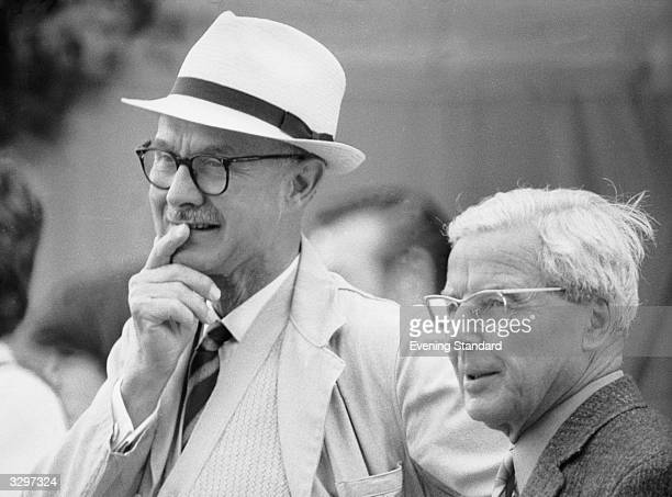Two men watch a women's cricket match at Lord's cricket ground London
