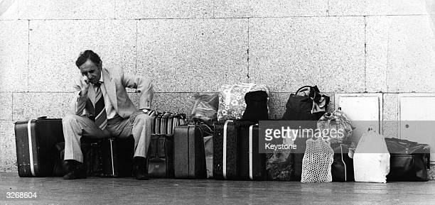 A holidaymaker at Central Warsaw Railway Station with a large amount of luggage