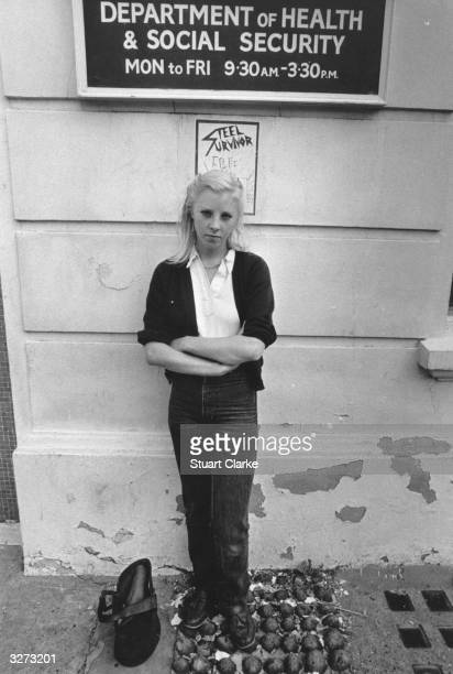 A young girl outside the Department of Health and Social Security after going to London to find work