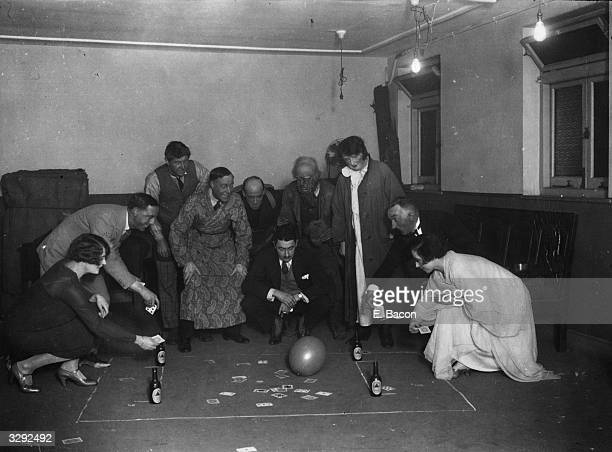 Members of the cast of 'Cuckoo In The Nest' at the Aldwych Theatre London enjoying an improvised game of football