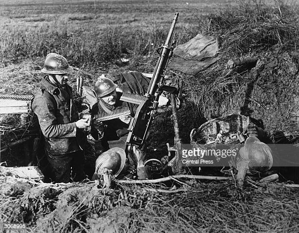 French antiaircraft gunners hide in their camouflaged trenches at the front line Their enemy is low flying aircraft