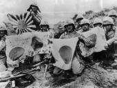 US 5th Division Marines display Japanese battle flags captured in the battle at Iwo Jima The US Army landed on Iwo Jima 19th February 1945