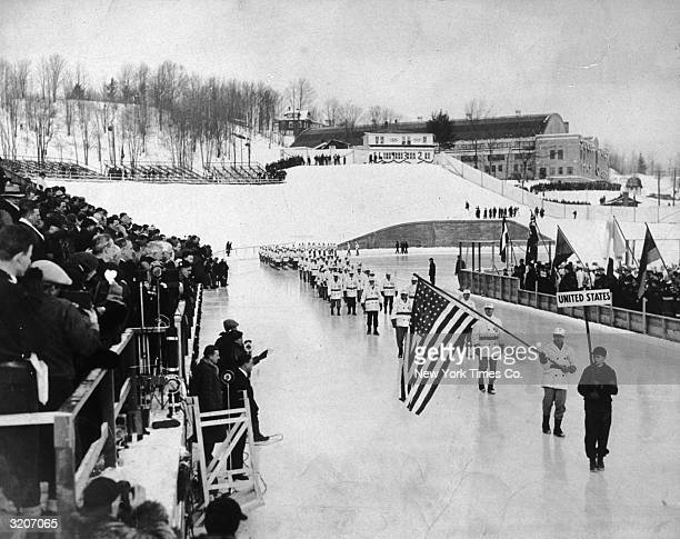 The United States Olympic team passing by Governor Franklin Delano Roosevelt during the procession at the opening ceremony of the Olympic Winter...