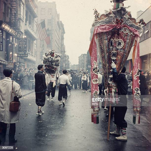 The Year Of The Rat is celebrated in Chinatown New York Dragon and lion dances are performed to the sound of gongs and drums in a huge street...