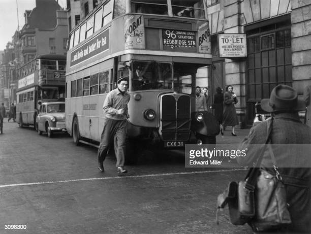 American boxer Joey Maxim jogs through London's Piccadilly whilst training for his upcoming title fight against lightheavyweight champion Freddie...