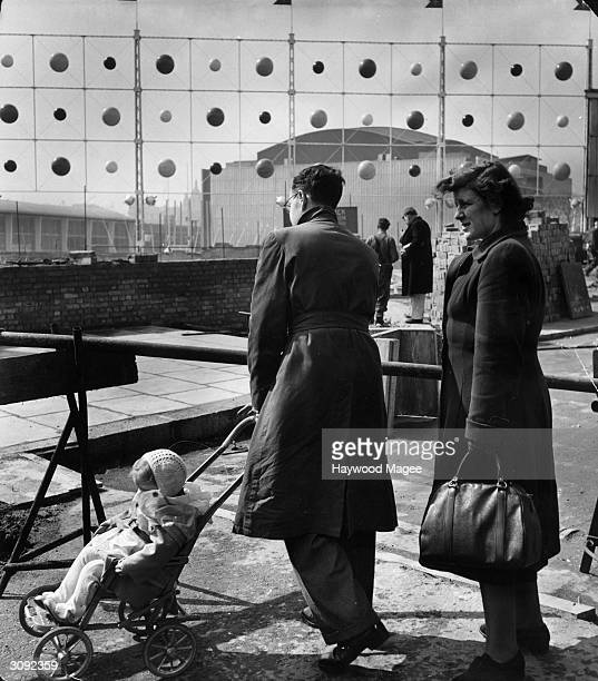 A family inspect the site of the Festival of Britain on the South Bank of the River Thames in London The exhibition aims to celebrates the centenary...