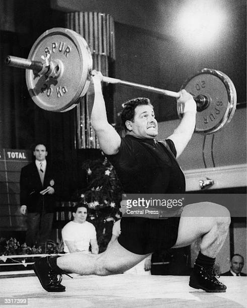 F Hupfer lifts weights for West Germany during the International Weightlifting Match against Great Britain held at the Municipal Hall Tottenham London