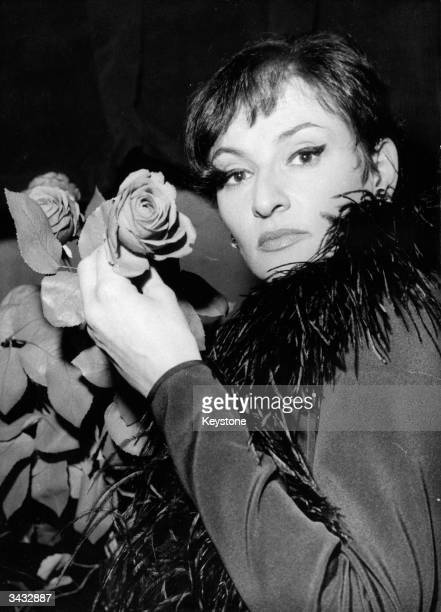 French music hall singer Barbara with rosebud