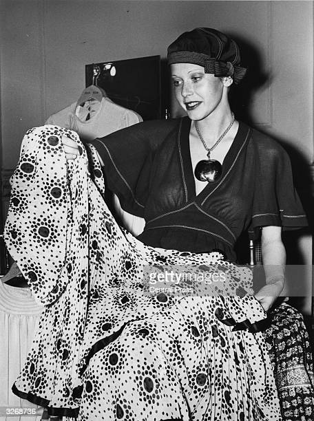 Dutch actress Sylvia Kristel at fashion designer Jean Muir's London showroom choosing dresses from the Spring Collection as part of her prize for...