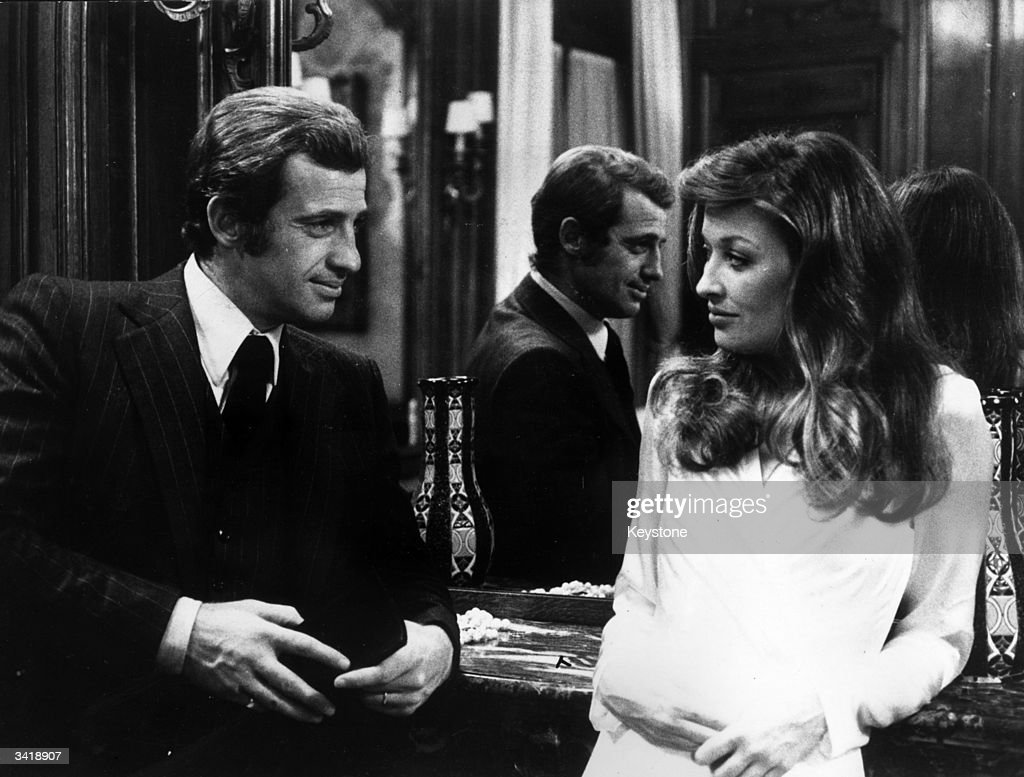 French actor JeanPaul Belmondo with actress Maureen Kerwin in a scene from the film 'L'Inheritier'