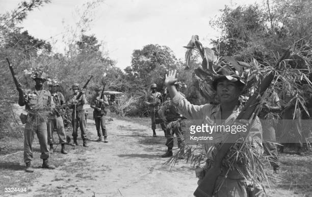 Men of the 27th 'Woolfhound' Division of the US Army learning guerilla warfare tactics around Korat north Thailand in preparation for the invasion of...