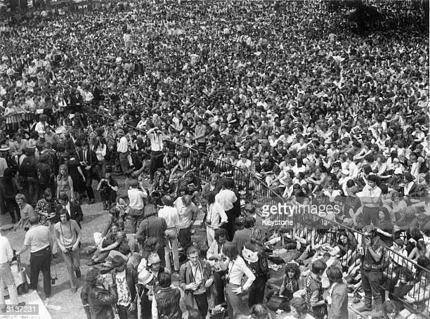 About 150000 pop fans attend a free openair concert in Hyde Park given by The Rolling Stones in memory of guitarist Brian Jones who died two days...
