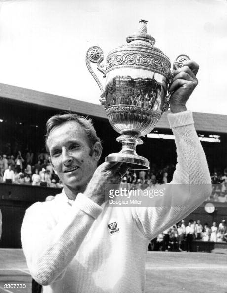 Australian tennis player Rod Laver lifts the trophy after beating John Newcombe of Australia in the men's singles final at Wimbledon