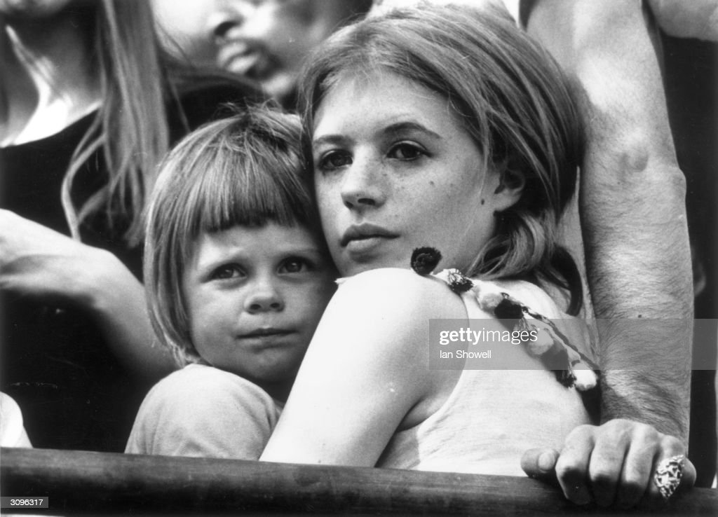 Marianne Faithfull and her young son Nicholas attend a Rolling Stones concert in London's Hyde Park. She is currently divorcing her husband John Dunbar to be with her boyfriend, singer Mick Jagger.
