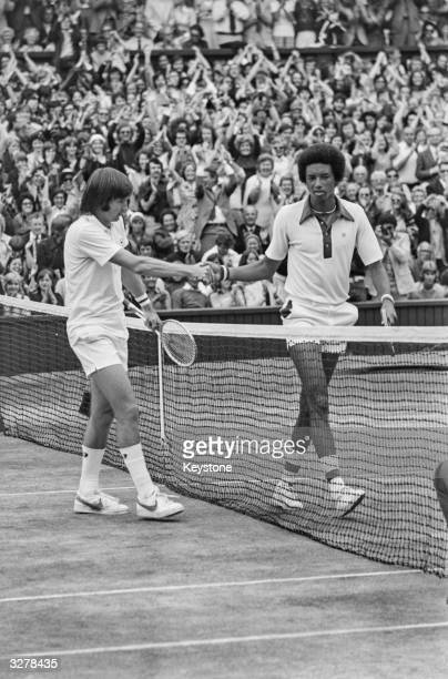 American tennis players Arthur Ashe and Jimmy Connors shaking hands after the men's singles final at the Wimbledon Lawn Tennis Championships which...