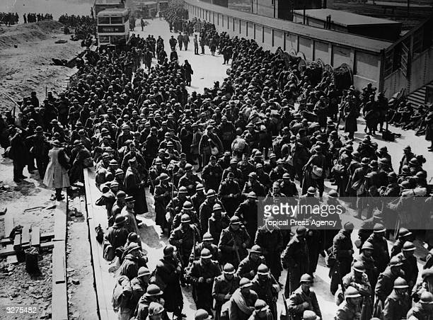 French marines and soldiers who have been fighting the rear guard action arrive at a South Coast town having been evacuated from Dunkirk