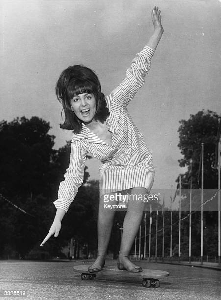 Actress Pauline Collins skateboarding in Battersea Park London