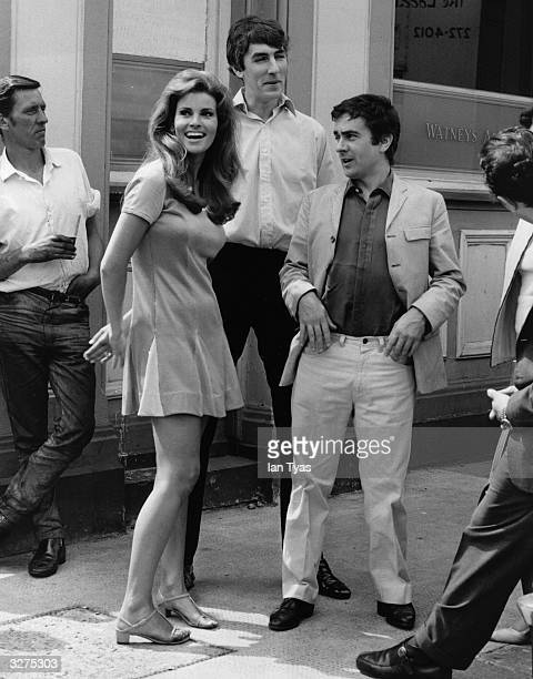 American film star Raquel Welch with British comedian and writer Peter Cook and British comedian Dudley Moore standing outside the Harwood Arms...