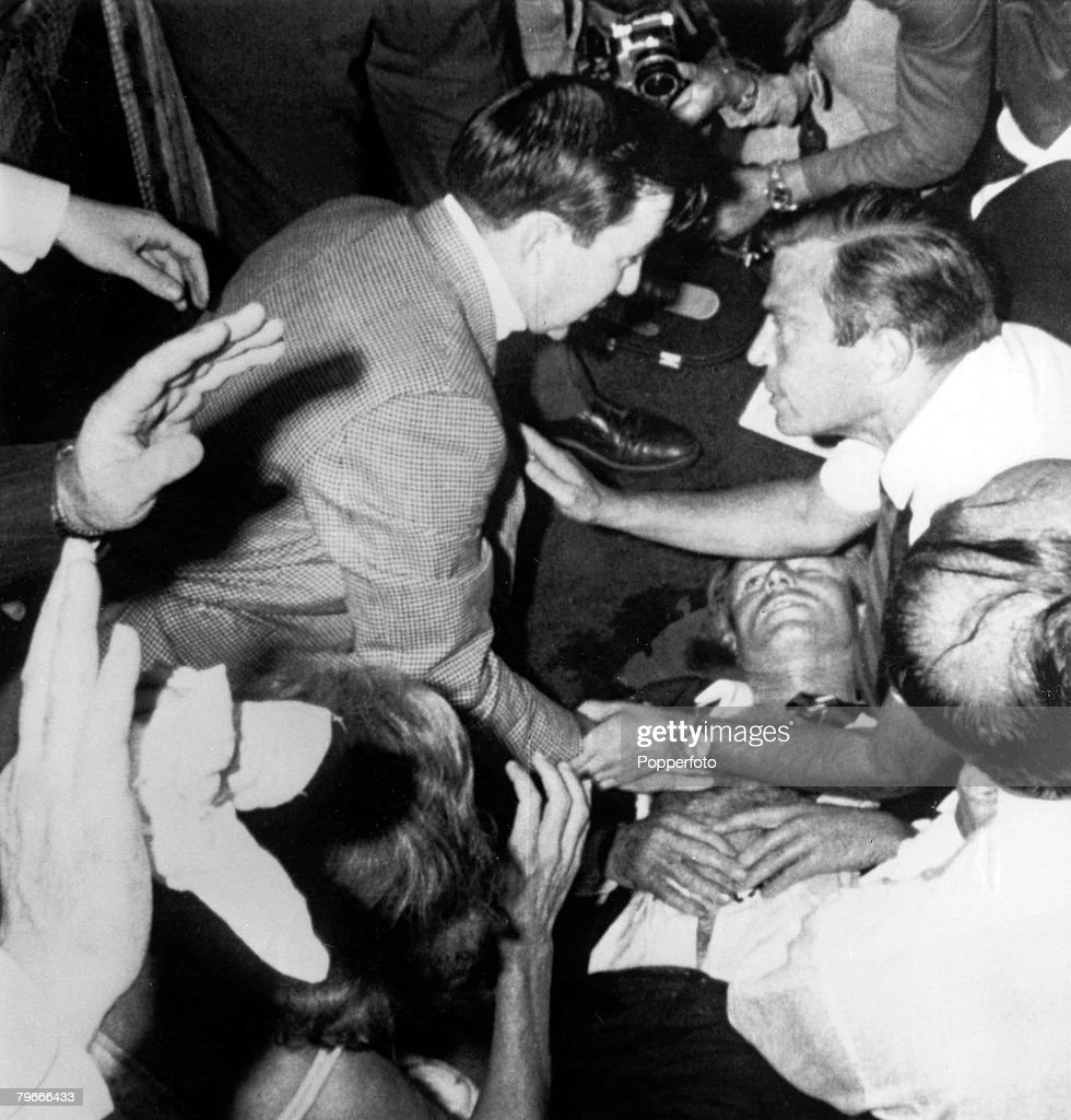 5th June 1968 Senator Robert F Kennedy lies on the floor of the Ambassador hotel his shirt is opened and one eye is closed just after being shot by...
