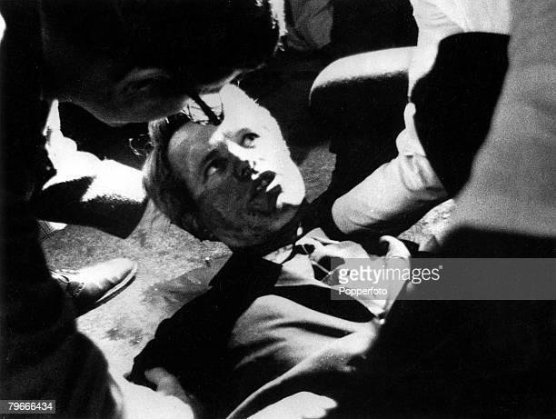 5th June 1968 Senator Robert F Kennedy lies on the floor of the Ambassador hotel his shirt is opened and he looks up at people assisting him just...