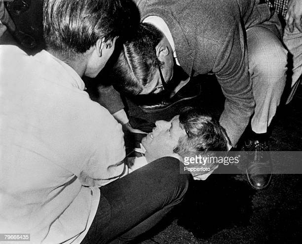 5th June 1968 Senator Robert F Kennedy lies on the floor of the Ambassador hotel his shirt is opened and he looks up at people assisting him with a...